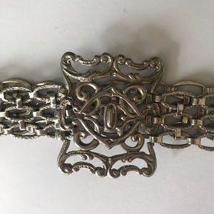 Vintage ornate silver toned belt.